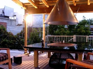 The deck has a fire pit.