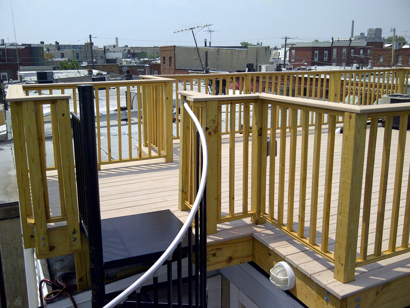 View of finished roof deck from stairway